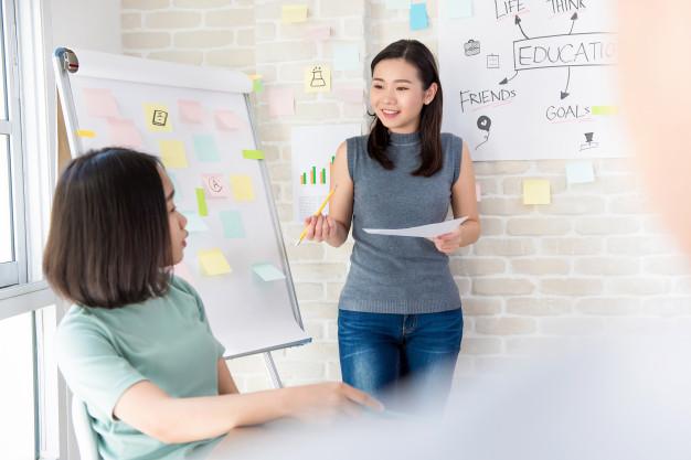 asian-female-college-student-making-presentation-classroom_8087-338