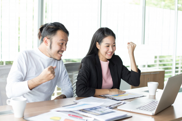 asian-man-working-project-with-woman-office-place_42892-67