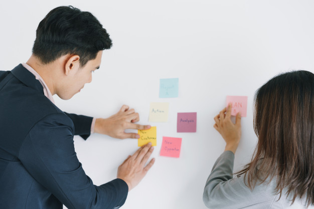 business-asian-two-people-meeting-office-using-post-it-notes-share-idea_7182-2273