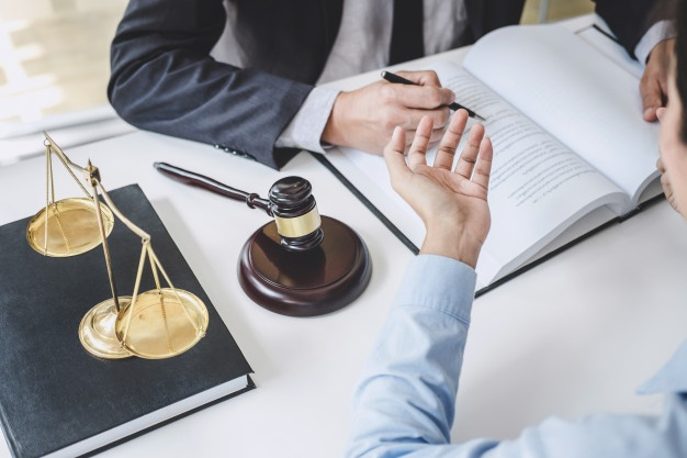 consultation-conference-male-lawyers-professional-businesswoman-working-discussion-having-law-firm-office-concepts-law-judge-gavel-with-scales-justice_28283-1408