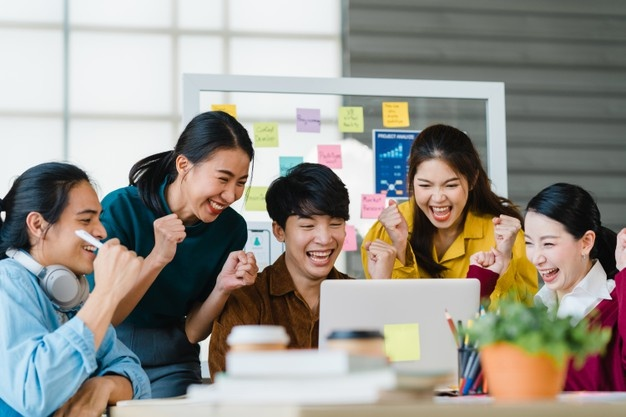 group-asia-young-creative-people-smart-casual-wear-discussing-business-celebrate-giving-five-after-dealing-feeling-happy-signing-contract-agreement-office-coworker-teamwork-concept_7861-2523