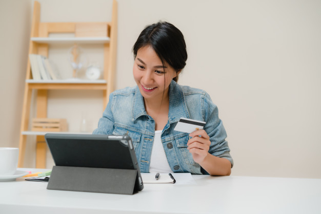 beautiful-smart-business-asian-woman-using-tablet-buying-online-shopping-by-credit-card-while-wear-smart-casual-sitting-desk-living-room-home-lifestyle-woman-working-home-concept_7861-1382