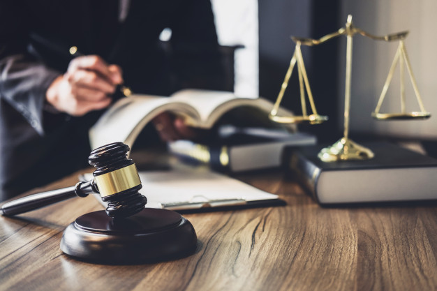 lawyer-judge-counselor-working-with-agreement-contract-courtroom_28283-730