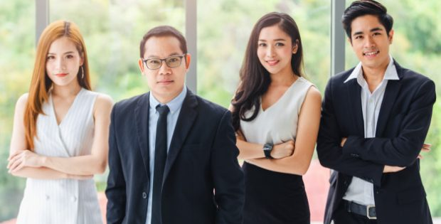 asian-business-team-standing-portrait-successful-company-workers_39730-1308