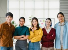 group-asia-young-creative-people-smart-casual-wear-smiling-arms-crossed-creative-office-workplace-diverse-asian-male-female-stand-together-startup-coworker-teamwork-concept_7861-2570